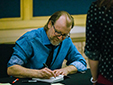 George Saunders signs books after an event.