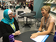 Mentor Najiyah Maxfield and her mentee, Cynthia Huijgens, at the AWP bookfair booth in Los Angeles, 2016.