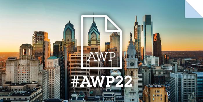 Philadelphia skyline behind a white #AWP22 dogeared page logo
